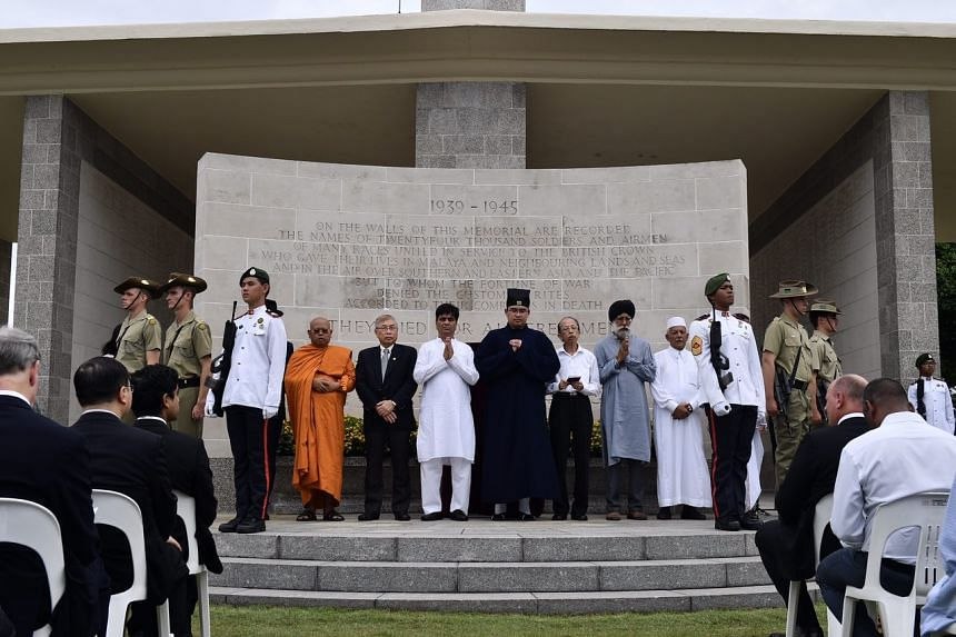 Religious leaders offer a silent prayer during the 75th anniversary of the fall of Singapore at Kranji War Cemetery on Feb 15, 2017.
