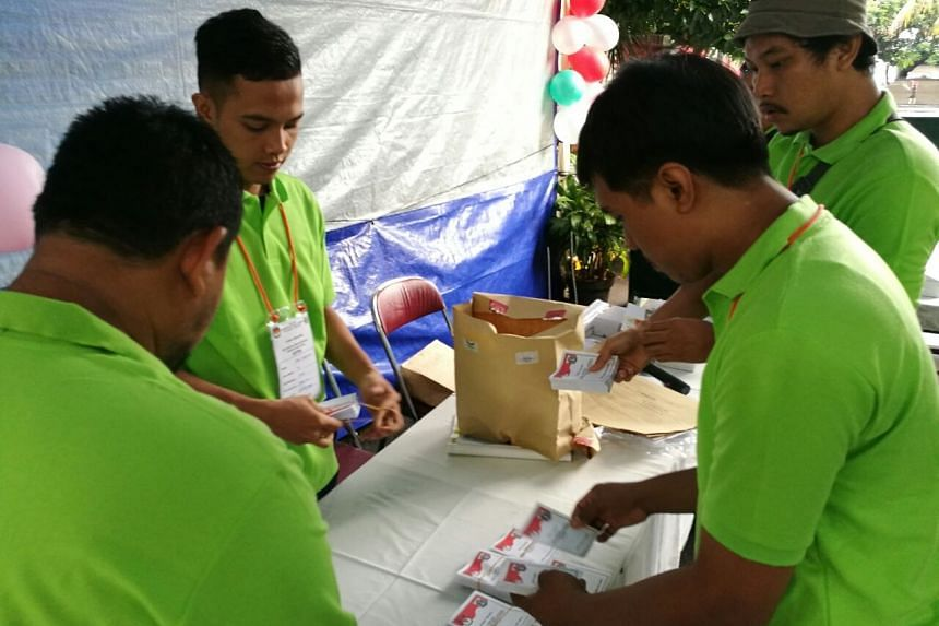 Officials at the polling station in Cipayung, East Jakarta.