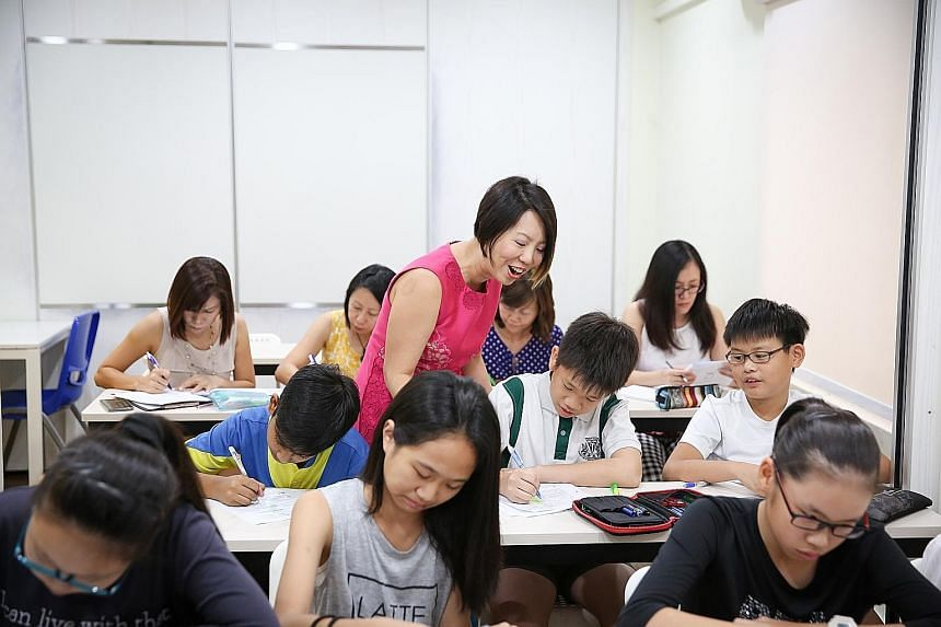 Parents accompanying students at a class by Ms Chuah (in pink), founder of Concept Math. More parents are attending crash courses to help their children with their studies. But an expert said such children may become dependent on their parents and de