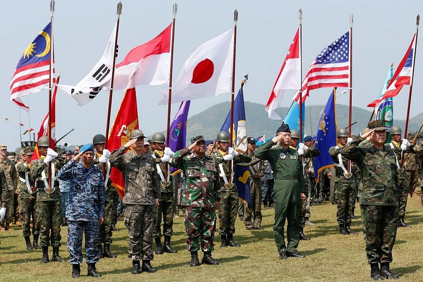 Soldiers from different Asia-Pacific countries at the opening of the Cobra Gold war games at Sattahip Royal Thai Marine Corps Base in Chonburi, Thailand, yesterday.