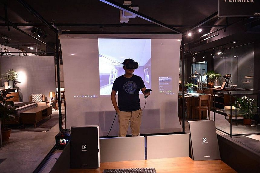 Members of the public can experience the dive for themselves next month, when the prototype of Hiverlab's VR training programme (left) is available at the Infocomm Media Development Authority's Pixel Labs. A customer trying out Commune's VR home-plan
