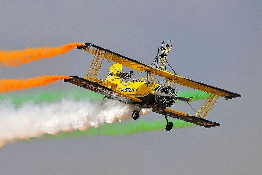 """Skycat Wingwalkers from the Scandinavian Airshow team performing at the start of Aero India 2017 in Bengaluru, India, yesterday. Asia's largest air show will draw top military contractors from around the world vying to be part of the government's """"Ma"""