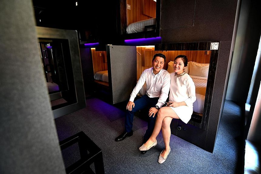 Married couple Benedict Choa and Sonia Anya in one of the rooms at the Cube boutique capsule hotel. Guests get their own private cabin fitted with a reading lamp, a safe, filtered air ventilators and a foldaway dressing table. The cabins are separate