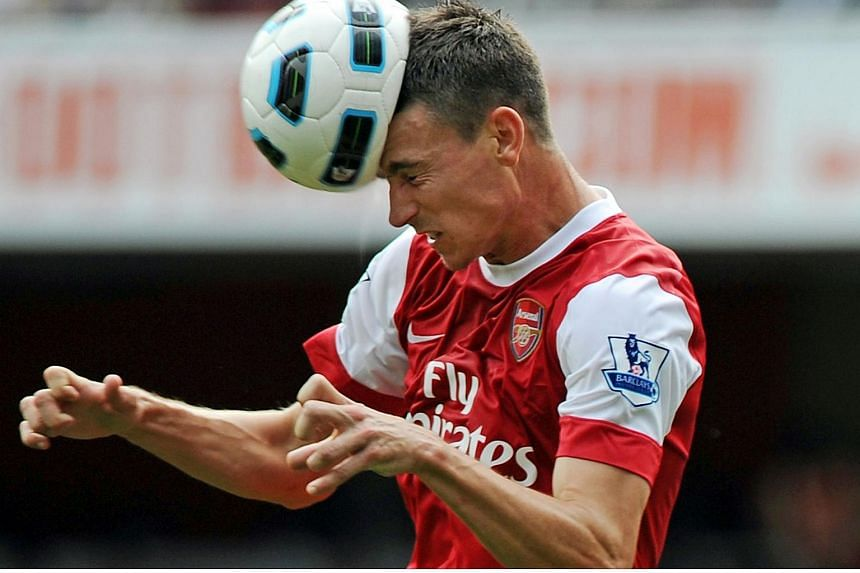 File photo of Laurent Koscielny heading the ball during an English Premier League football match in 2010. According to a study, professional football players are at heightened risk of developing a degenerative brain disease.