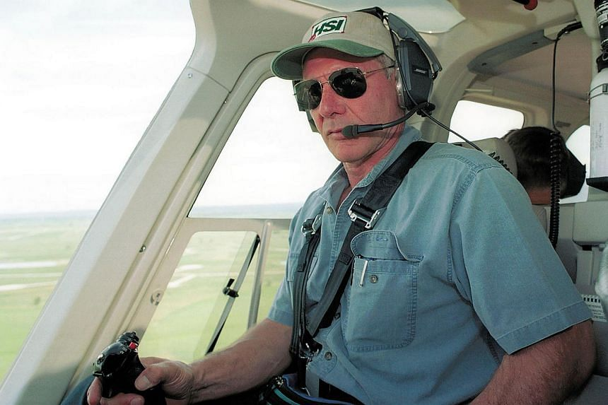 A file photo taken on July 9, 2001, shows actor Harrison Ford flying his helicopter near Jackson, Wyoming.