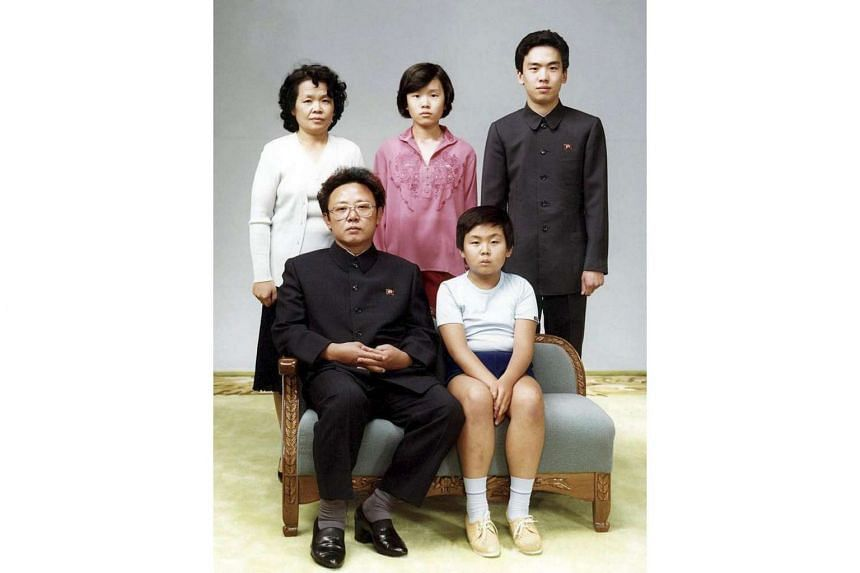 A picture taken in August 1981 at an unknown location showing Kim Jong Nam (front row, right), the half brother of North Korean leader Kim Jong Un, together with his father Kim Jong Il.
