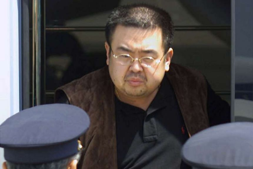 A man believed to be North Korean heir-apparent Kim Jong Nam emerging from a bus as he is escorted by Japanese authorities upon his deportation from Japan at Tokyo's Narita international airport, on May 4, 2001.