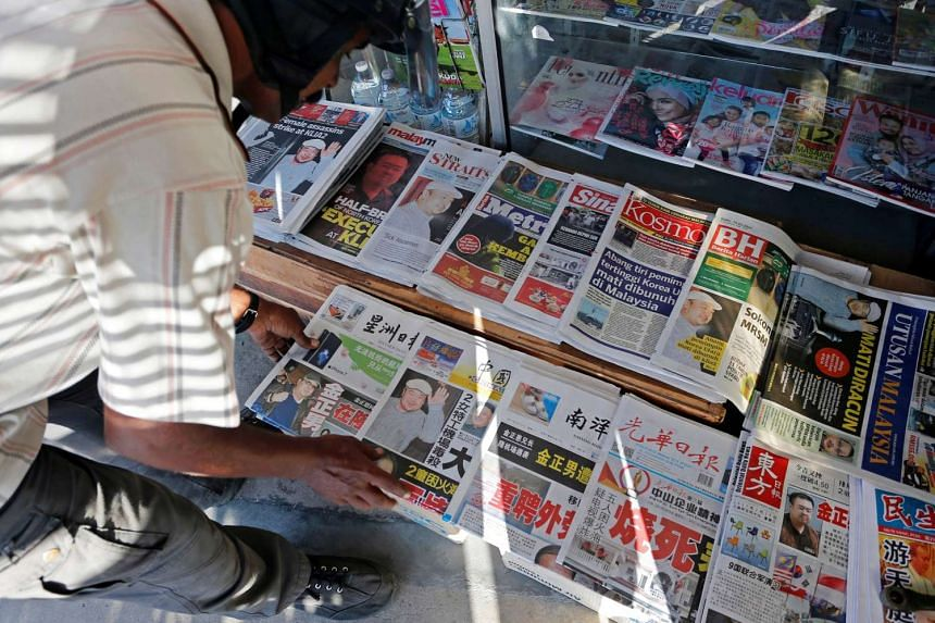 Newspapers showing front pages with images of Kim Jong Nam are seen at a news-stand outside Kuala Lumpur on Feb 15, 2017.