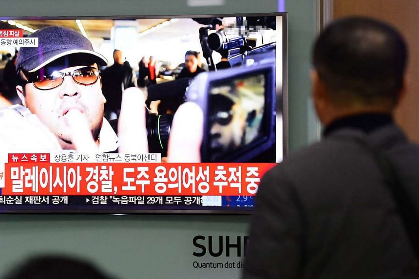 People watching a TV screen showing a news report about the assassination of Kim Jong Nam, at a train station in Seoul on Feb 14, 2017.