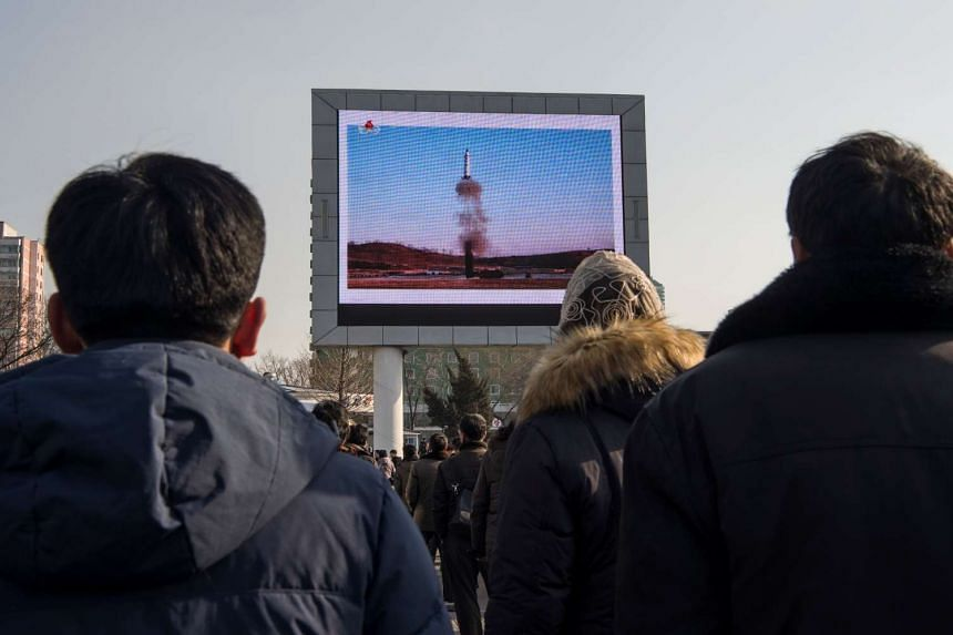 People in Pyongyang watching a public broadcast about the launch of a surface-to-surface medium long-range ballistic missile Pukguksong-2 at an undisclosed location on Feb 12.