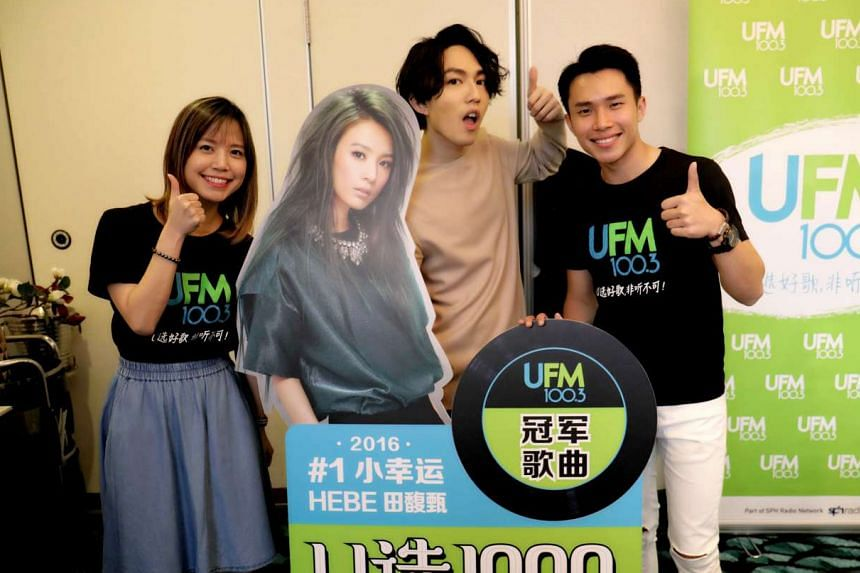 Yoga Lin (centre) with UFM100.3 DJs Xinying (left) and Weilong.