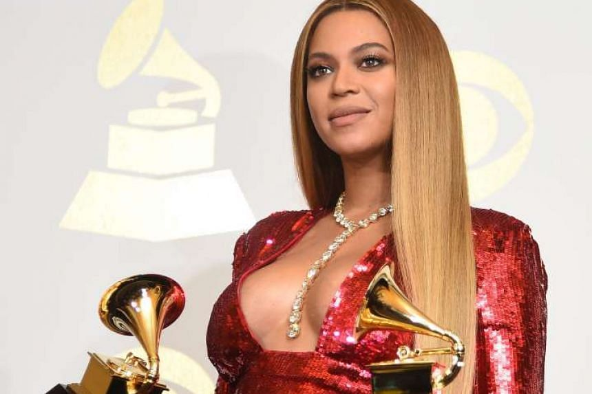Beyonce with her Grammy trophies, which she won for Best Urban Contemporary Album and Best Music Video.