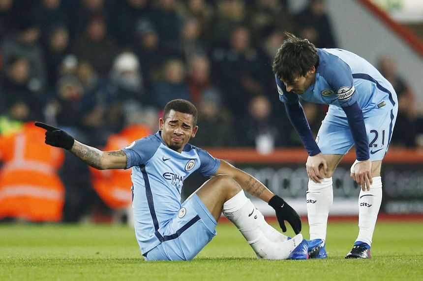 Manchester City's Gabriel Jesus looking distraught after suffering an injury in the 15th minute as team-mate David Silva looks on. City beat Bournemouth 2-0 to go second in the Premier League, eight points behind runaway leaders Chelsea but will likely lo