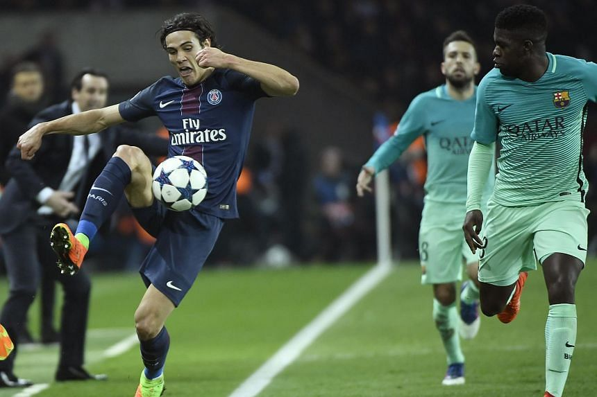Paris Saint-Germain's Uruguayan forward Edinson Cavani (left) vying with Barcelona's French defender Samuel Umtiti during the UEFA Champions League round of 16 first leg football match at the Parc des Princes stadium in Paris, on Feb 14, 2017.