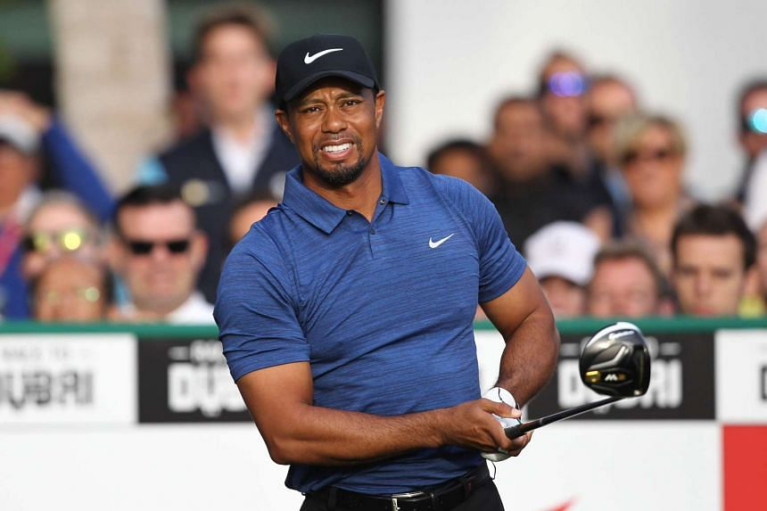 Woods reacts after playing a shot during the Dubai Desert Classic on Feb 2, 2017.