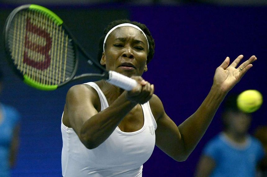 US Venus Williams hitting a return against France's Kristina Mladenovic during the second round of the WTA St Petersburg Ladies Trophy 2017 tennis tournament in Saint Petersburg on Feb 2, 2017.