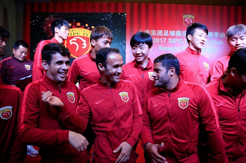 Brazilian soccer players Oscar (front, left) and Hulk (front, right) and Portuguese soccer player Ricardo Carvalho (front, centre) are pictured for SIPG Football Club on Feb 13, 2017.