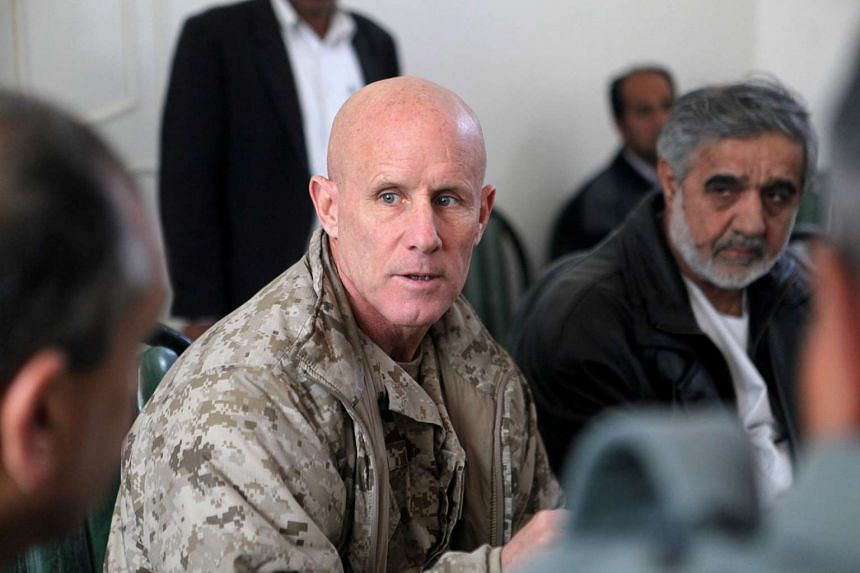 Vice-Admiral Robert Harward speaks to an Afghan official during a visit to Zaranj, Afghanistan, in a Jan 6, 2011 handout photo.