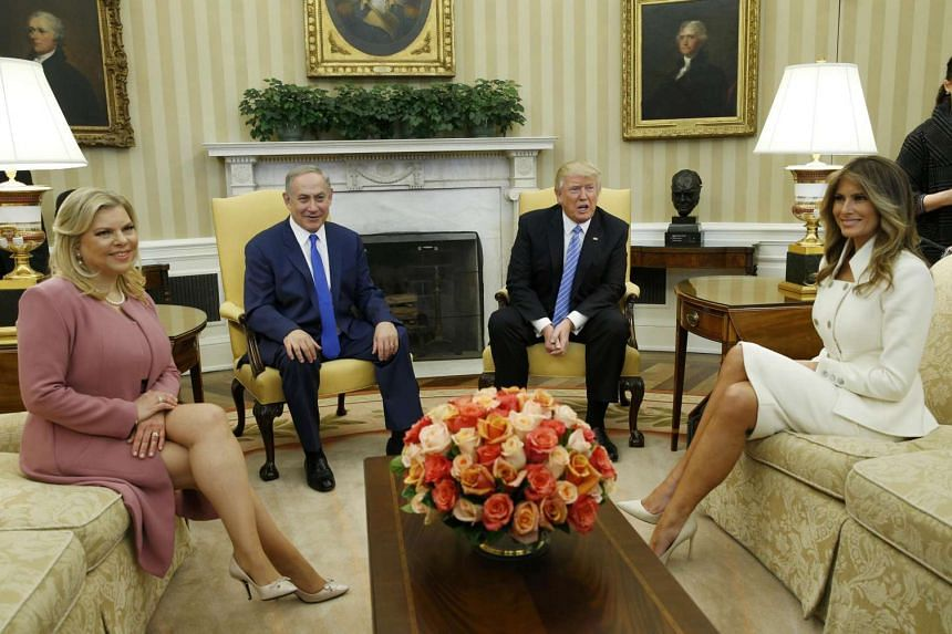 US President Donald Trump (second right) and First Lady Melania Trump meet Israeli Prime Minister Benjamin Netanyahu and his wife Sara (left) in the Oval Office.
