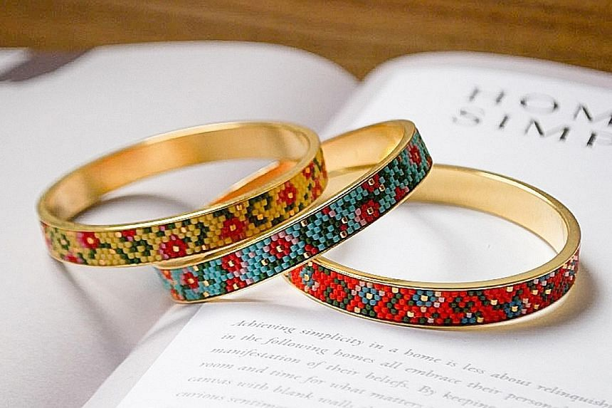 Hand-woven 24k gold-plated bangles, $189 each