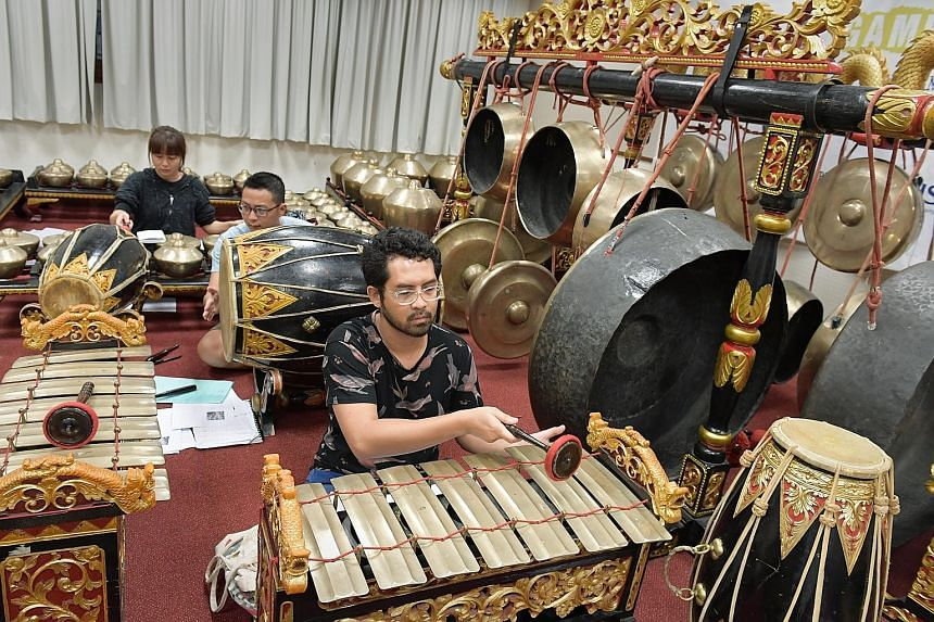 (From far left) Singa Ngalaras Gamelan Ensemble members Lam Guan Yu, Thow Xin Wei and Haider Sahle. About a third of the members of this NUS group are not of Javanese descent.