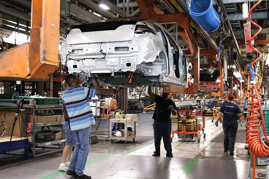 A General Motors plant in Michigan. Suppose the Trump administration forced through changes in Nafta so as to bring all parts of the car production process back to the US. The result will be to make US-produced cars more expensive. How is that going