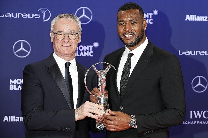 Leicester boss Claudio Ranieri (left) and captain Wes Morgan pose with the Spirit of Sport award at the Laureus World Sport Awards. Leicester were also nominated for the Breakthrough of the Year award.