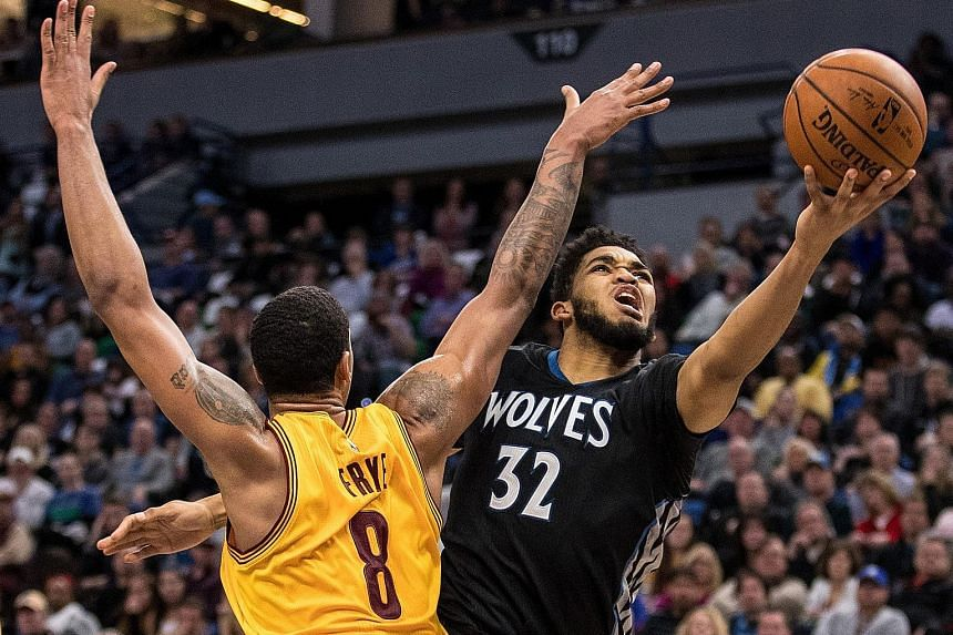 Timberwolves centre Karl-Anthony Towns drives to the basket as Cavaliers forward Channing Frye attempts to defend at Target Centre. He finished with 26 points while Frye had 21 points. Frye typically comes off the bench for Cleveland but the 33-year-