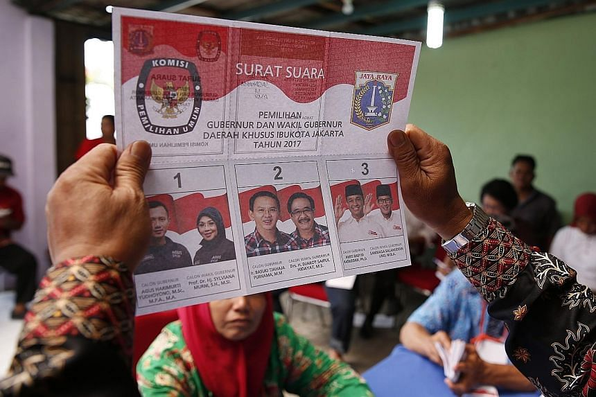 Voters waiting to cast ballots at a polling station in Glodok, in Jakarta's Chinatown.