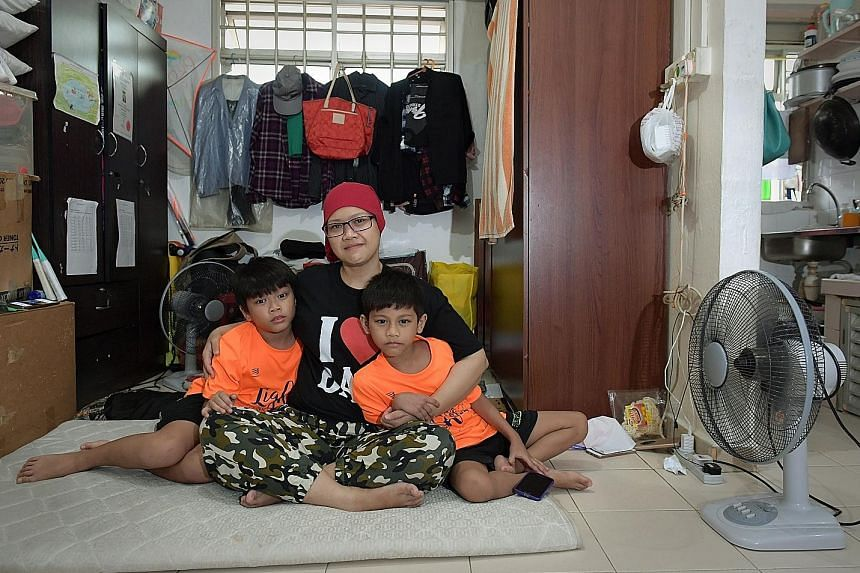 Ms Rene shares her parents' one-room rental flat with an adult nephew and her sons Mohd Haiman Razin (left) and Nor Hizamie Razin. The family has lived there since mid-2012. Her application for a rental flat was turned down but she hopes that HDB wil
