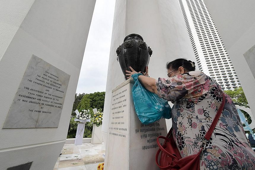 Representatives of various school uniformed groups paying their respects at the Civilian War Memorial in Beach Road at the annual memorial service.