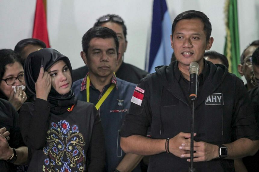 Agus Harimurti Yudhoyono (right) delivers his speech at his campaign team's headquarters in Menteng, Central Jakarta. On the left is his wife Annisa Pohan.