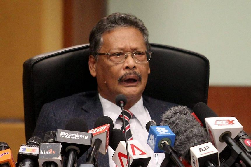 Attorney-General Tan Sri Mohamed Apandi Ali speaks during a press conference at his office in Putrajaya.