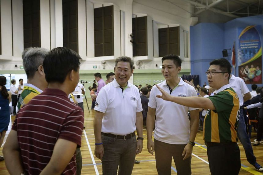 Minister Tan Chuan-Jin (second from right) having a chat with Mr Raymond Chua (right), a 47-year-old regional director, and his group of fellow fathers of students from Catholic High, on Feb 16, 2017.