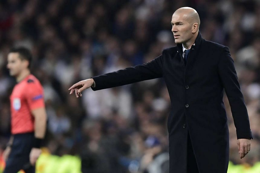 Real Madrid coach Zinedine Zidane giving instructions on the sidelines during the Uefa Champions League match against SSC Napoli on Feb 15, 2017.