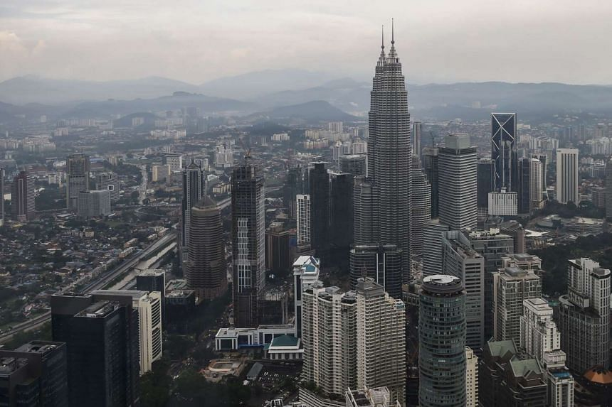 Malaysia's landmark Petronas Twin Towers and other commercial buildings are seen from the KL Tower observation deck in Kuala Lumpur.