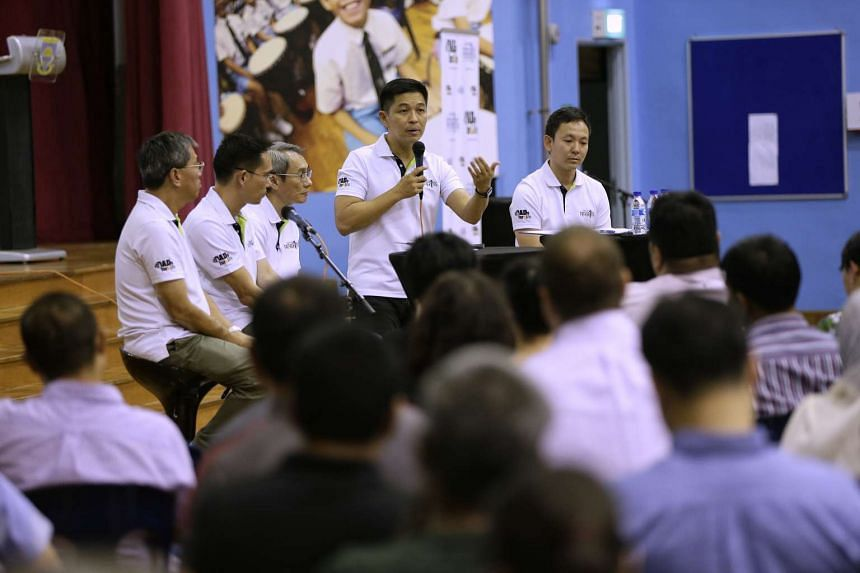 Minister for Social and Family Development Tan Chuan-Jin (second from right) engaging fathers in a dialogue at Northland Primary School on Feb 16, 2017.