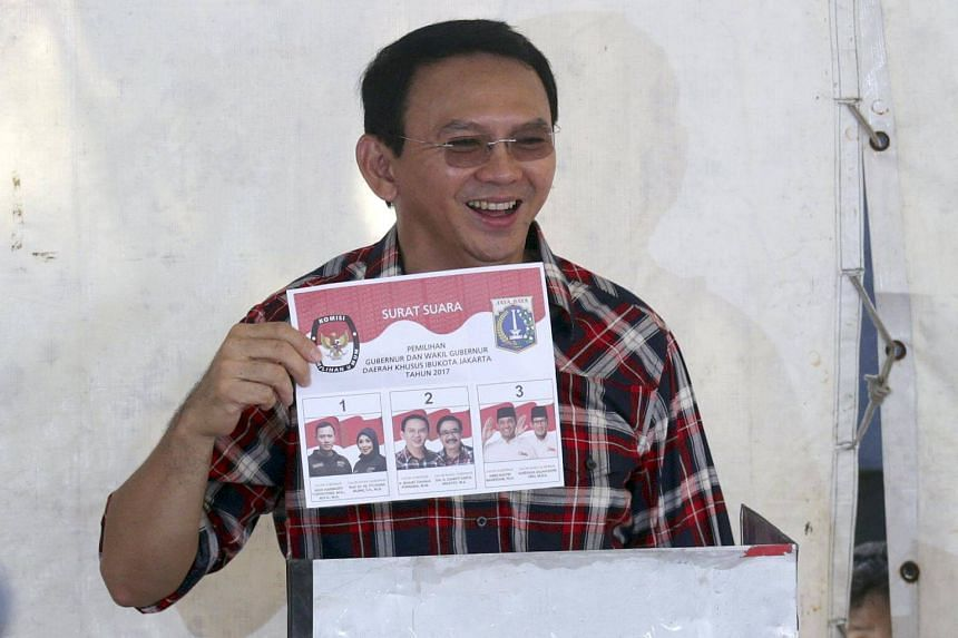 Basuki Tjahaja Purnama, popularly known as Ahok, showing his ballot paper during the regional elections in Jakarta, Indonesia, on Feb 15, 2017.