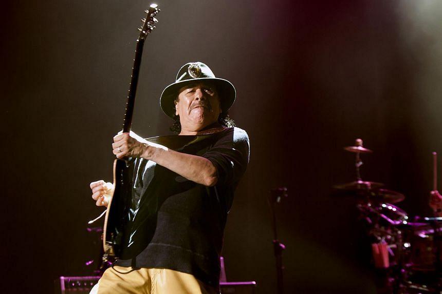 Carlos Santana performing at the Singapore Indoor Stadium.