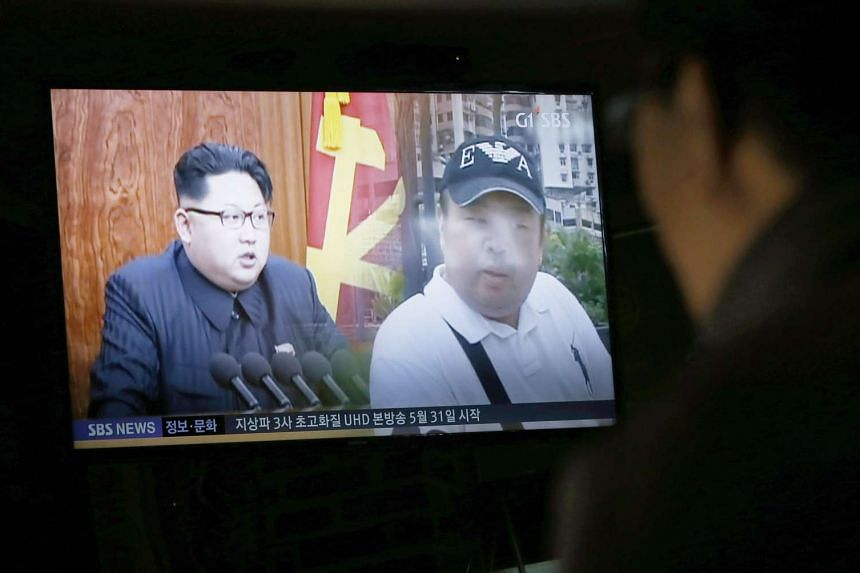 A news report on the assassination of Kim Jong Nam is seen on a TV screen at a restaurant in Pyeongchang, Gangwon-do, South Korea, on Feb 15, 2017.