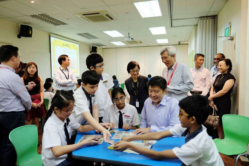 Education Minister (Schools) Ng Chee Meng playing a round of SG Unite! with Primary 6 students from St Hilda's Primary School.