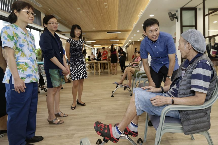 Mr Chee speaking to a day care patient at Assisi Hospice yesterday. As the population ages, palliative care is becoming increasingly important, he said.