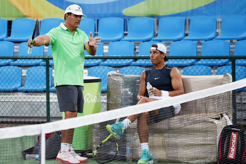 Spain's Rafael Nadal (right) listening to his coach and uncle Toni Nadal during training at the Rio de Janeiro Olympics.