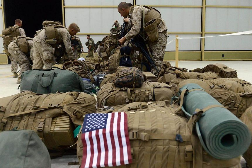 File photo of US troops in Kandahar, Afghanistan, in 2014. The US Defense Department may recommend that the US deploy regular combat troops to Syria to fight Islamic State militants.