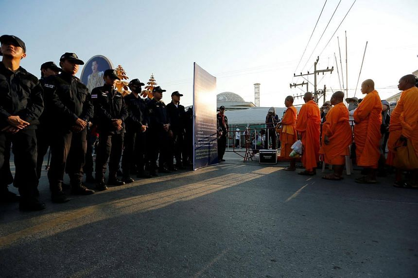 Thai police block Buddhist monks at the gate of Dhammakaya temple in Pathum Thani province, Thailand.