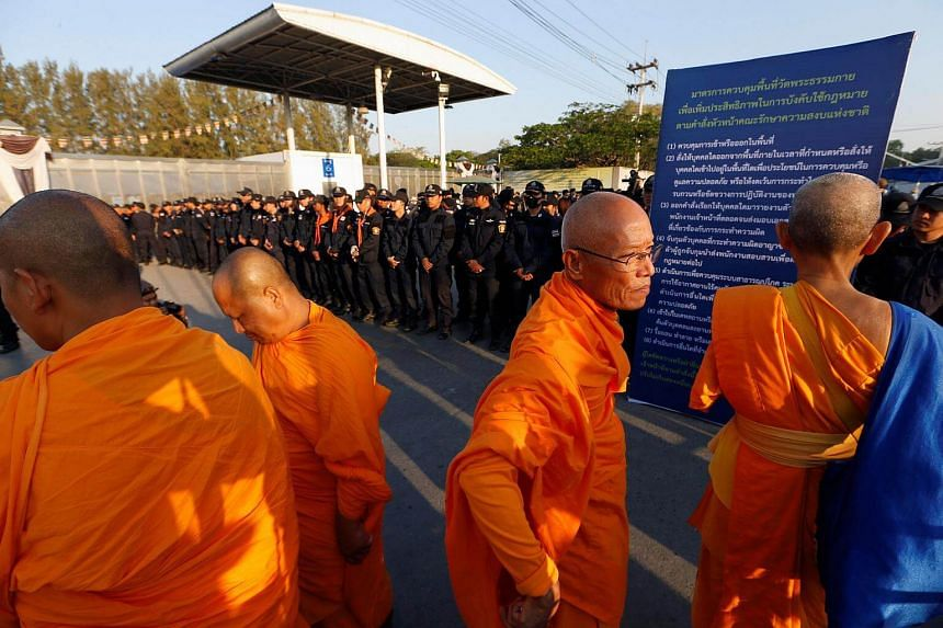 Thai police block Buddhist monks at the gate of Dhammakaya temple in Pathum Thani province, north of Thailand.