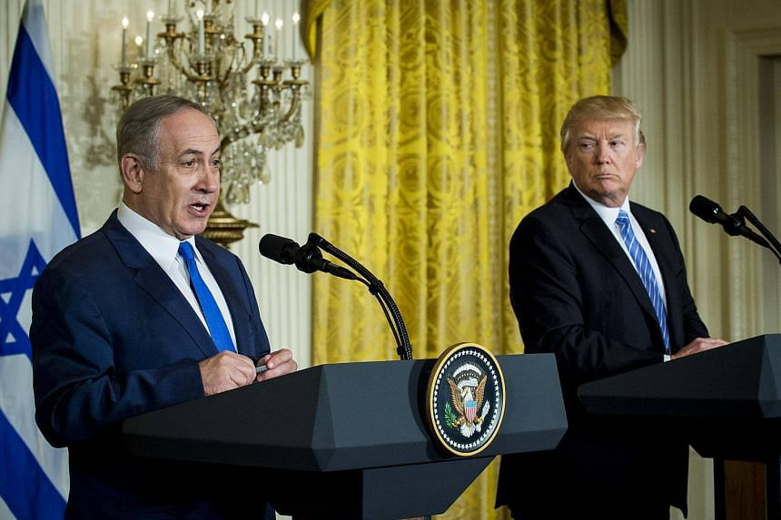 US President Donald Trump(right) listens while Benjamin Netanyahu, Israeli's prime minister, speaks during a news conference in the East Room of the White House in Washington DC.