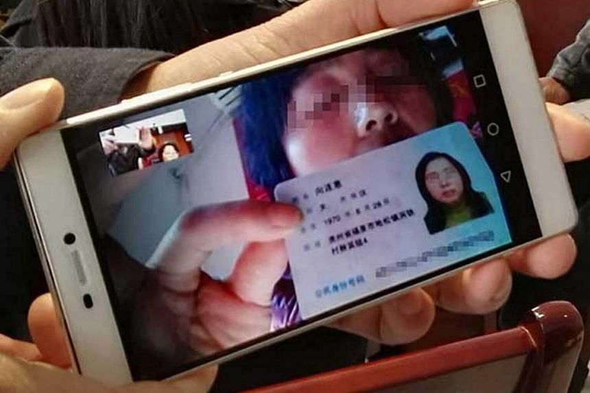 A plaintiff shows her ID card in a WeChat video call during the trial.