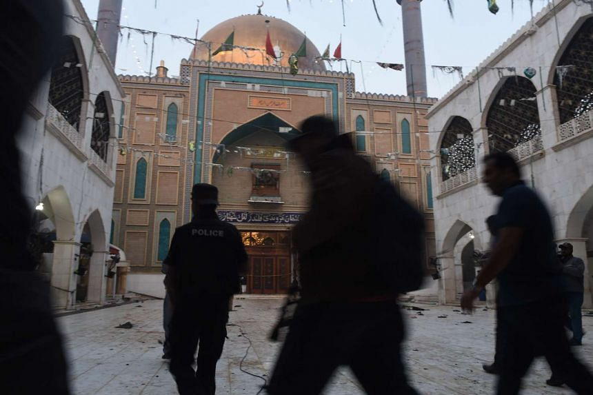 Pakistani security personnel stand guard at the Muslim Sufi shrine of Lal Shahbaz Qalandar a day after a bomb attack in the town of Sehwan in Sindh province on Feb 17, 2017.