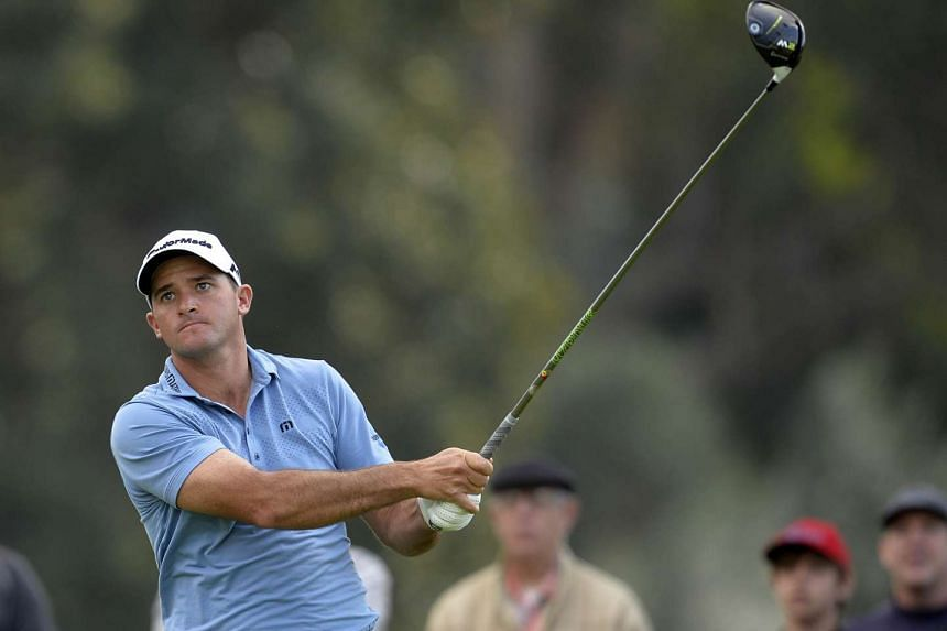 Sam Saunders hits from the ninth hole tee box during the first round of the Genesis Open golf tournament at Riviera Country Club.